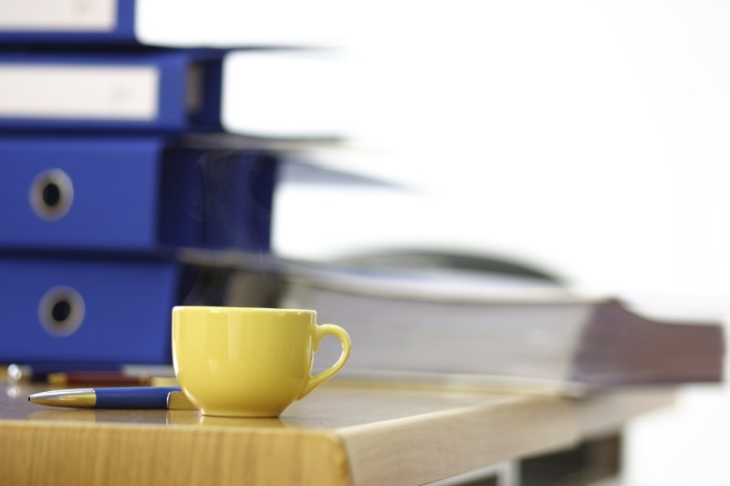 moving binder with coffee cup