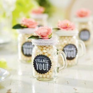 Mason jars filled with white jellybeans