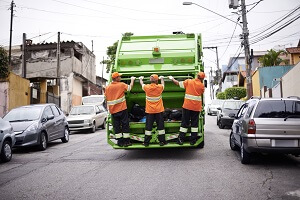 Junk removal crew and dump truck