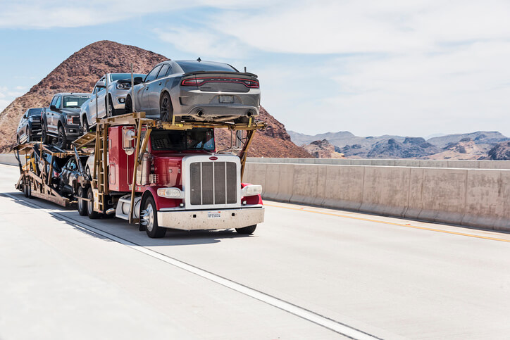 Truck shipping several cars