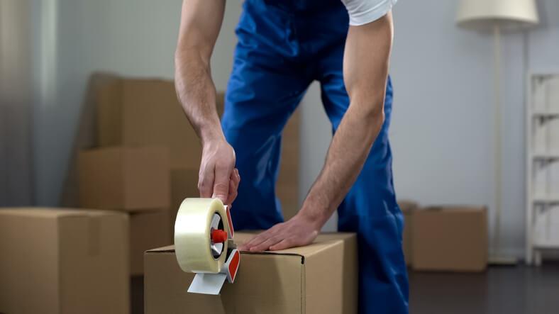 Man packing moving box