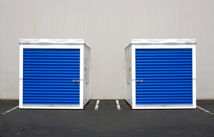 Two moving containers side by side.