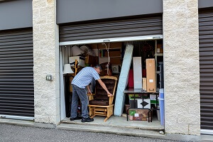 Man packing a temporary storage unit