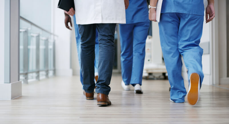 Healthcare workers walking down hall