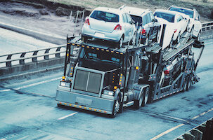 Auto transport semi drives on the open highway