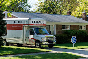 Uhaul moving truck in a residential driveway