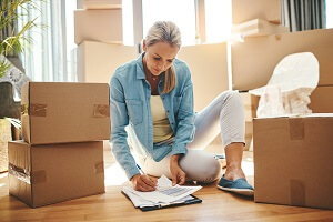 Woman completing her moving paperwork
