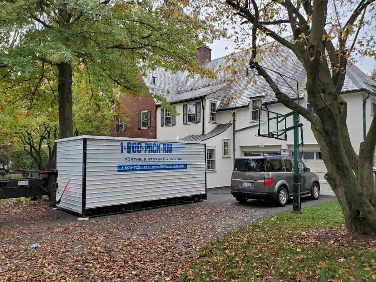 A 1-800-PACK-RAT moving container is dropped off at a customer's home in West Hartford, CT.