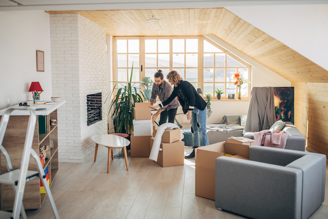 Young couple moving into an apartment
