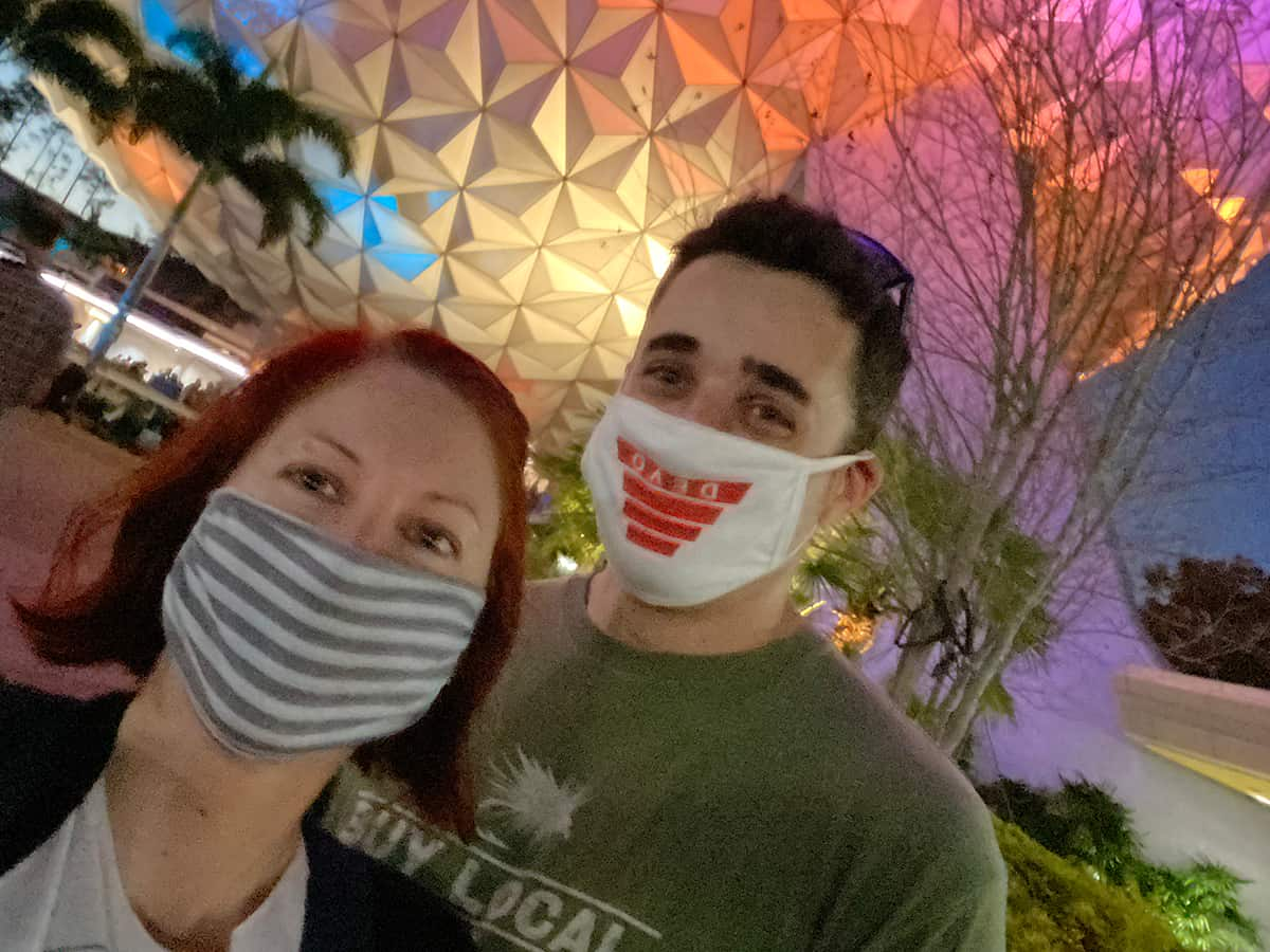 A couple posing for a selfie at Epcot theme park.