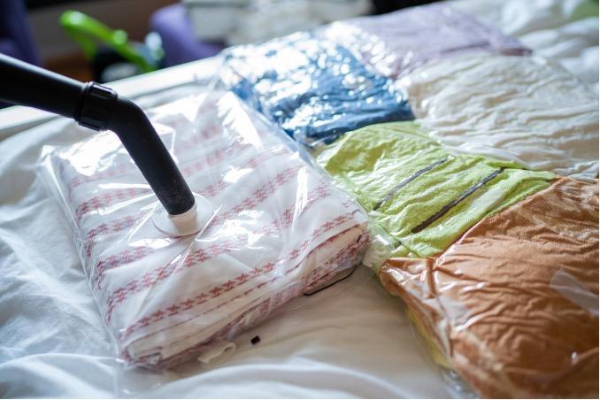 Vacuum packing clothes in plastic