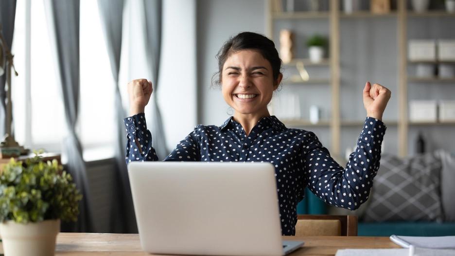 Woman celebrates winning an online auction