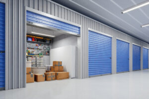 Open storage unit with boxes, tools, and bins.